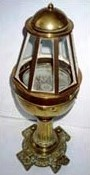 19th century yacht binnacle with dry compass mounted in gimbals beneath the binnacle, with six glass windows on a circular brass base.