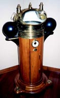 19th century ship's binnacle with dry compass and kerosene lamps.
