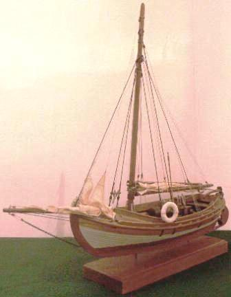 Gaff-sail rigged open boat with compression-ignition engine.