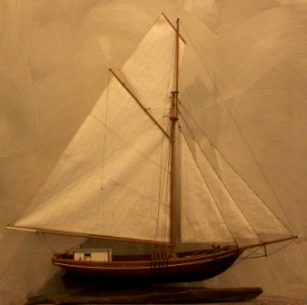 20th century wooden sloop, as used in Stockholms archipelago, mounted on salvaged wooden base.