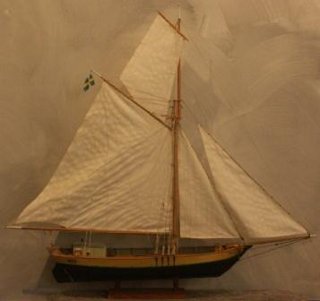 20th century wooden cargo boat Josefina with fine details and loaded with firewood.