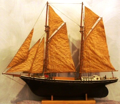 Early 20th century ketch-rigged model with nicely furnished cabin.
