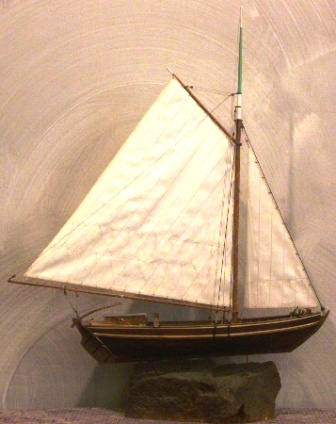 20th century wooden cargo boat, as used in Stockholms archipelago for transportation of sand, mounted on stone base.