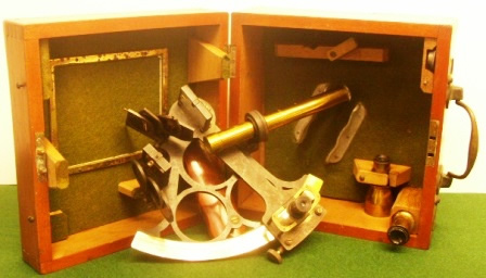 20th century sextant in original mahogany case. Made by T.L. Ainsley, South Shields, circle frame, silver scale and adjustable magnifier to assist scale readings, three telescopes and one sun-filter.