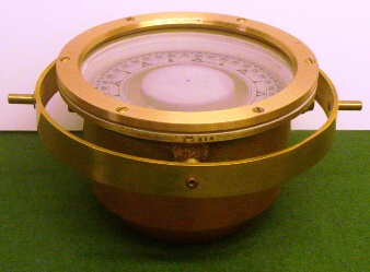 Polished 20th century compass with copper bowl, brass ring and floating compass card. Made by P.W. Lyth, Stockholm.