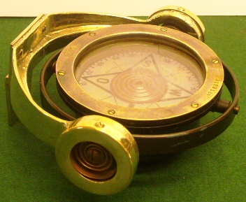 20th century compass mounted in gimbals and furnished with wall-bracket. Made by AB Lyth, Stockholm.