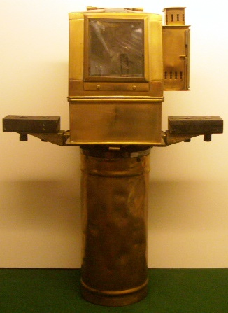 20th century brass binnacle mounted on brass stand with wall mounting support. Brass dome with kerosene lamp. Maker unknown, dated 1952 and furnished with compass made by AB Lyth, Stockholm.
