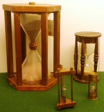 19th and 20th century sand glasses mounted in wooden or brass frame.