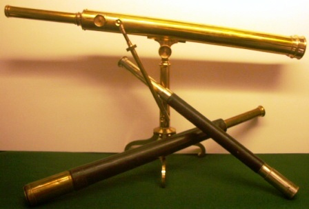 19th century hand-held and stand-mounted telescopes bound in leather, ray-skin or mahogany veneer.