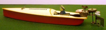 20th century sheet-metal powerboat toy model, fitted with outboard motor.