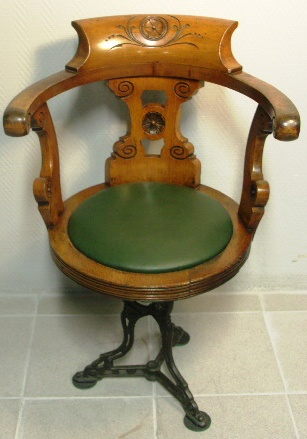 Swivel-chair in mahogany with cast-metal base. Leather seat. Late 19th century.