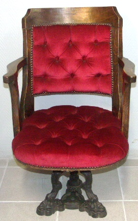 Swivel-chair in oak with cast-metal base, ca 1900.