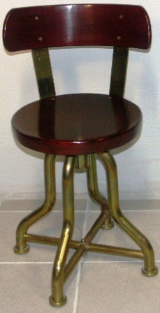 Swivel-chair in mahogany and brass. 1950's.