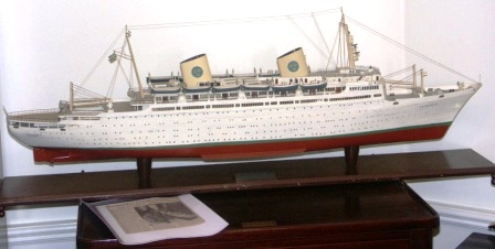 20th century built wooden model depicting the Swedish American Liner (SAL) M/S GRIPSHOLM of Gothenburg. Scale 1:200. Built by H. Strömqvist 1959-60. Partly illuminated and incl electric powered engine.