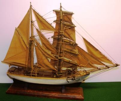20th century built model with set sails depicting a 19th century brigantine.