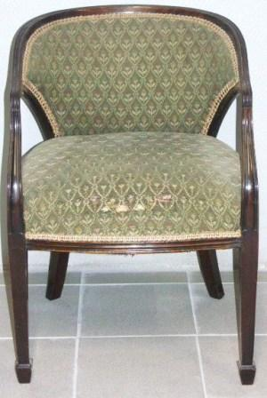 Mahogany armchair with original fabric from the passenger ship Berengaria, built 1913 at Vulkan Werke, Hamburg, Germany.