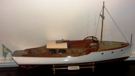 20th century built painted mahogany model depicting the ''halvsalong'' motorboat DISA, designed by Ruben Östlund 1930. Incl framed drawing.