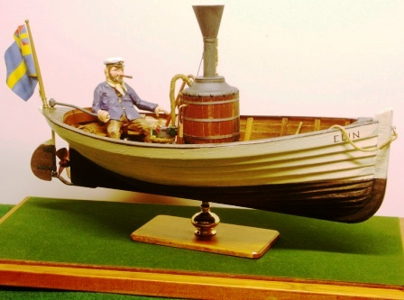 20th century built model depicting the 19th century steam-skiff powered ELIN with Captain Sune at the tiller