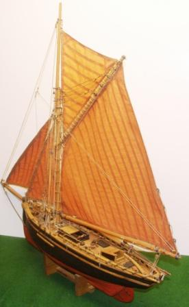 A very detailed 20th century wooden model depicting a 19th century North Sea Fishing Cutter, fully equipped with fishing gear.