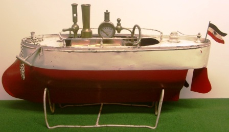 Sheet-metal built steamboat from the German Emperor period (early 20th century), complete with steam engine, binnacle and rotating anchor winch