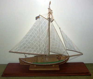 "Mid 20th century built model depicting ""Ålands seglande fisksump JEHU"". A typical gaff rigged fishing boat from Åland/Baltic Sea. Mounted in a glass case."