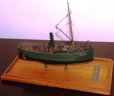 F.H. Kockum 1876. Depicting the first icebreaking tug-boat built by Kockums Shipyard (Malmö, Sweden) in 1876. 20th century model. Very fine details. Mounted in a glass case.