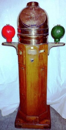 Early 20th century ship's binnacle with floating compass card, mounted in gimbals. Brass dome mounted on teak stand. Made by Plath & Co, Hamburg.