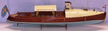 "20th century built model depicting a saloon boat launched 1908 by Reversator Shipyard Sweden and flying the KSSS (Royal Swedish Yacht Club) standard. Please note last photo of ""bottoming""."