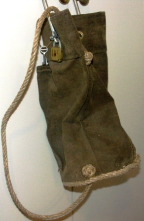 20th century canvas bag with metal loop and padlock