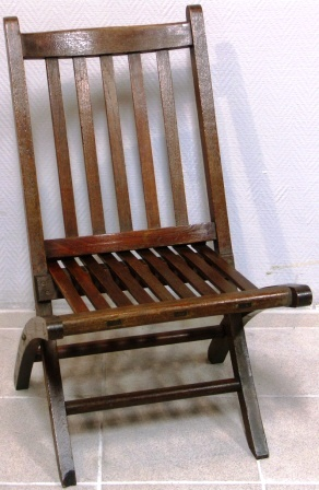 Small folding deck chair made of teak from S.S. Mauretania by Hughes Bolckow Ltd. Blyth, Northumberland