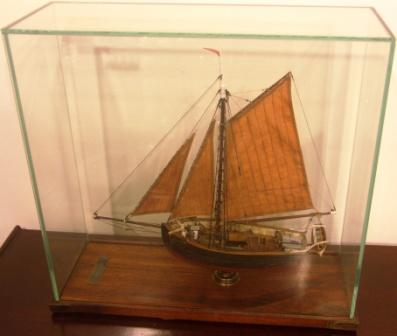 Texerina, built in Höganäs 1847, dismantled in Borgholm 1934. Model mounted in glass case; Length 39cm, width 14cm, height 35cm (glass case)